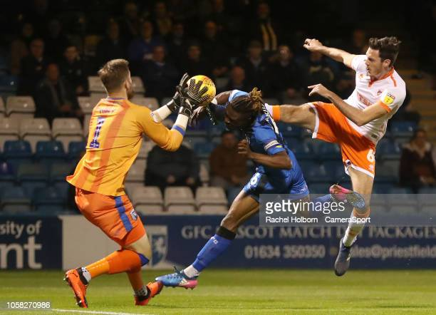Blackpool's Ben Heneghan forces a save from Gillingham's Tomas Holy during the Sky Bet League One match between Gillingham and Blackpool at...