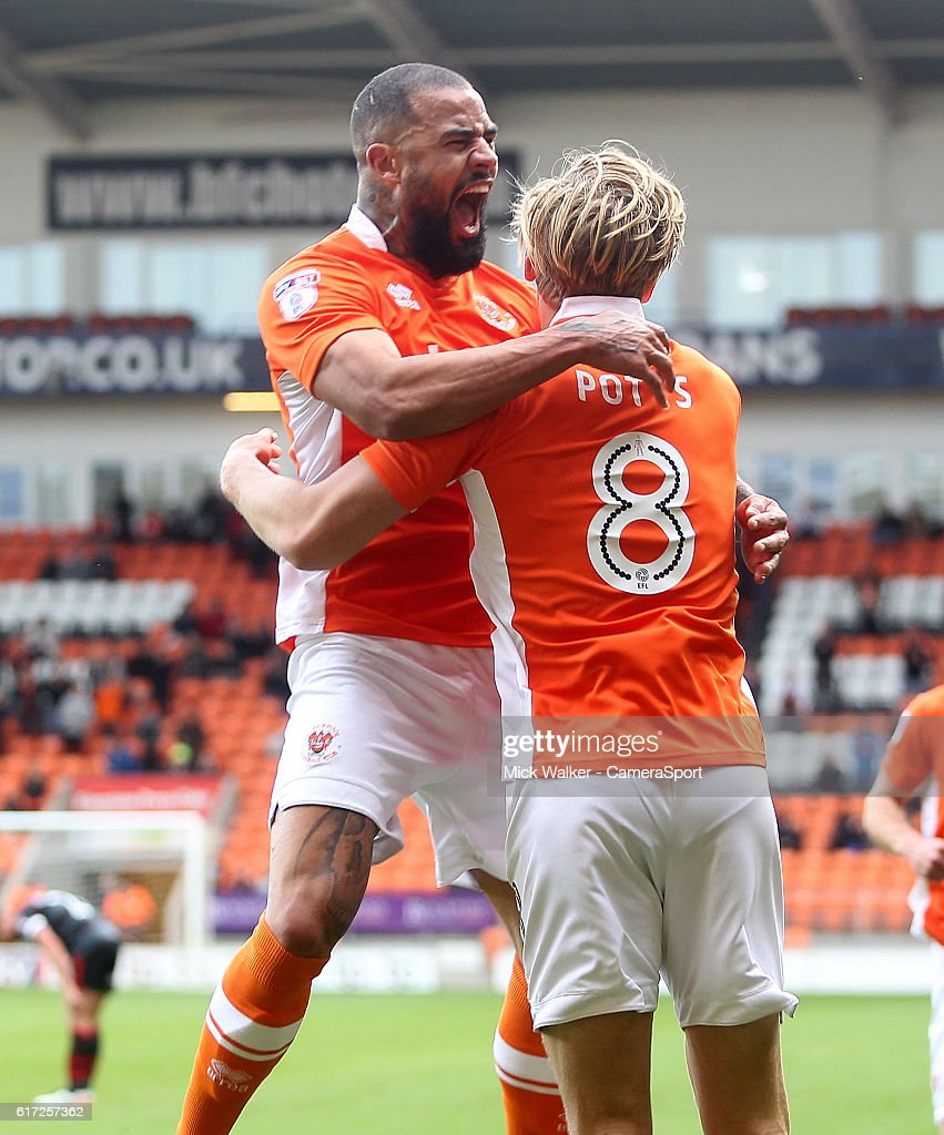 Blackpool's Brad Potts celebrates scoring his sides first goal with Kyle Vassell during the Sky Bet League Two match between Blackpool and Doncaster Rovers at Bloomfield Road on October 22, 2016 in Blackpool, England.