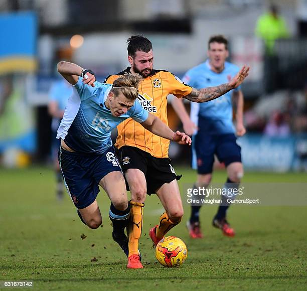 Blackpool's Brad Potts is fouled by Cambridge United's James Dunne during the Sky Bet League Two match between Cambridge United and Blackpool at...