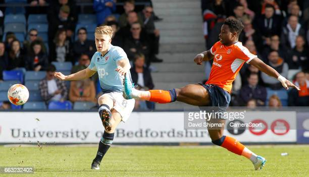Blackpool's Brad Potts plays the ball forward during the Sky Bet League Two match between Luton Town and Blackpool at Kenilworth Road on April 1,...
