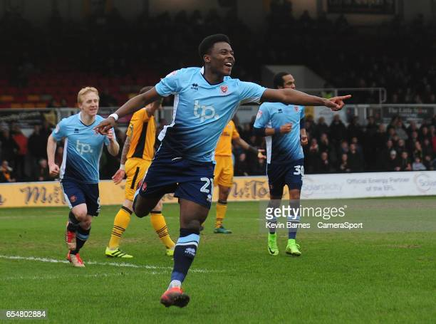 Blackpool's Bright OsayiSamuel celebrates scoring his sides first goal during the Sky Bet League Two match between Newport County and Blackpool at...