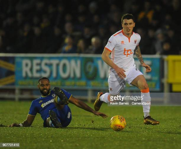 Blackpool's Callum Cooke goes past AFC Wimbledon's Liam Trotter during the Sky Bet League One match between AFC Wimbledon and Blackpool at The Cherry...