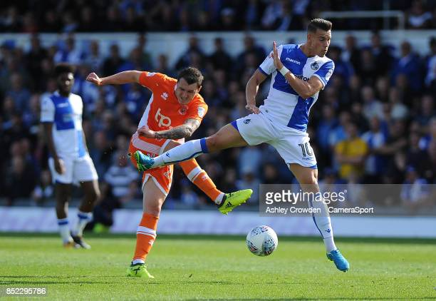 Blackpool's Callum Cooke has his shot at goal blocked by Bristol Rovers' Billy Bodin during the Sky Bet League One match between Bristol Rovers and...