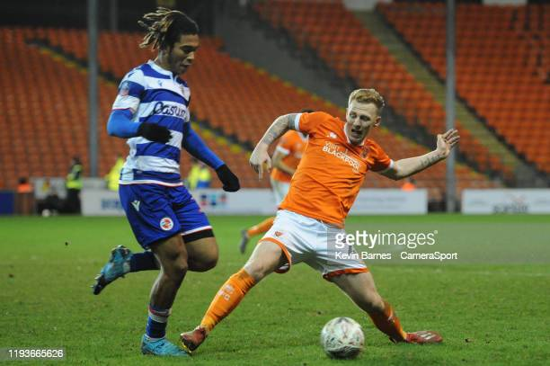 Blackpool's Callum Guy vies for possession with Reading's Danny Loader during the FA Cup Third Round Replay match between Blackpool and Reading at...