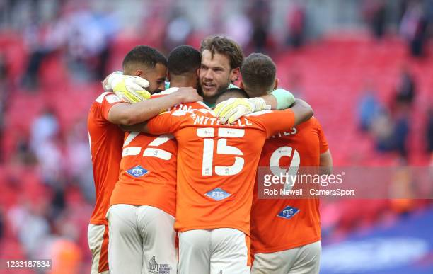 Blackpool's Chris Maxwell leads the celebrations at the final whistle during the Sky Bet League One Play-off Final match between Blackpool and...
