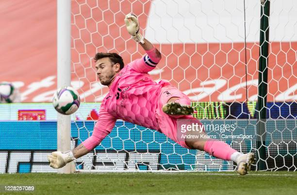 Blackpool's Chris Maxwell saves a penalty during the shoot out during the Carabao Cup First Round match between Stoke City and Blackpool at Bet365...