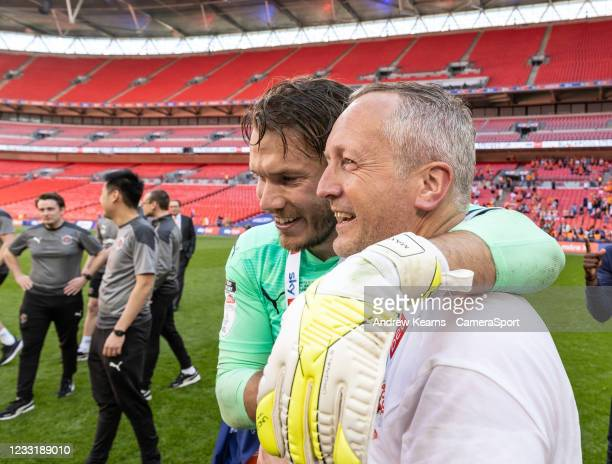 Blackpool's Chris Maxwell with head coach Neil Critchley during the Sky Bet League One Play-off Final match between Blackpool and Lincoln City at...