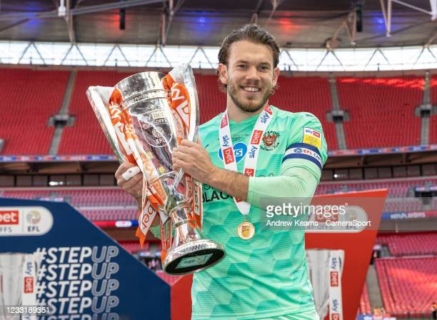 Blackpool's Chris Maxwell with the EFL trophy during the Sky Bet League One Play-off Final match between Blackpool and Lincoln City at Wembley...