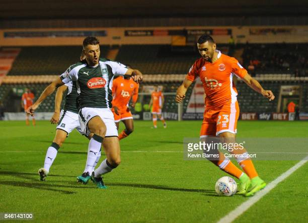 Blackpool's Colin Daniel under pressure from Plymouth Argyle's Ryan Edwards during the Sky Bet League One match between Plymouth Argyle and Blackpool...