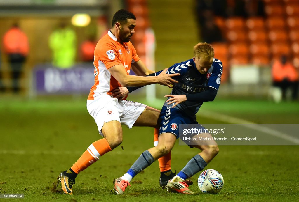 Blackpool's Colin Daniel vies for possession with Charlton Athletic's Ben Reeves during the Sky Bet League One match between Blackpool and Charlton Athletic at Bloomfield Road on March 12, 2018 in Blackpool, England.