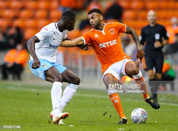 Blackpool's Curtis Tilt battles with Coventry City's Amadou Bakayoko during the Sky Bet League One match between Blackpool and Coventry City at...