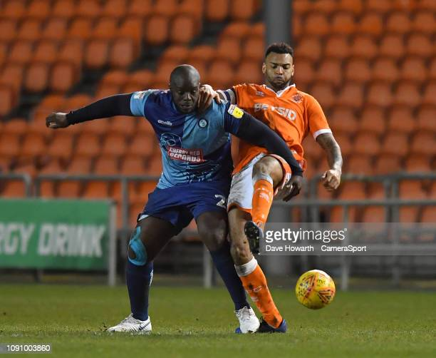 Blackpool's Curtis Tilt battles with Wycombe Wanderers' Adebayo Akinfenwa during the Sky Bet League One match between Blackpool and Wycombe Wanderers...