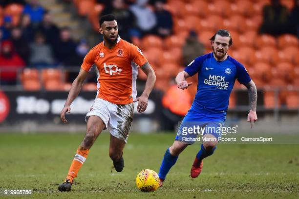 Blackpool's Curtis Tilt competes with Peterborough United's Jack Marriott during the Sky Bet League One match between Blackpool and Peterborough...