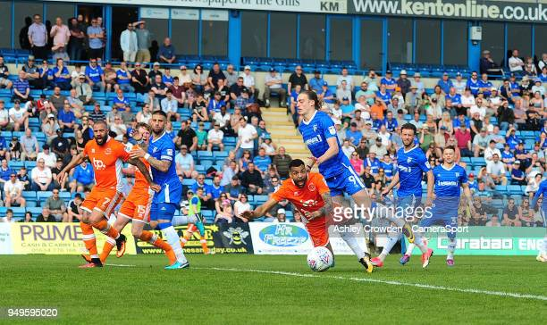Blackpool's Curtis Tilt is fouled by Gillingham's Tom Eaves during the Sky Bet League One match between Gillingham and Blackpool at Priestfield...