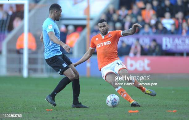 Blackpool's Curtis Tilt under pressure from Southend United's Timothee Dieng during the Sky Bet League One match between Blackpool and Southend...