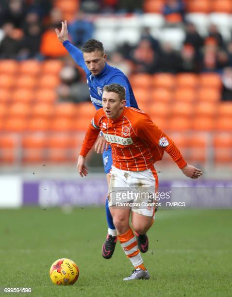 Blackpool's David Ferguson and Gillingham's Aaron Norris battle for the ball