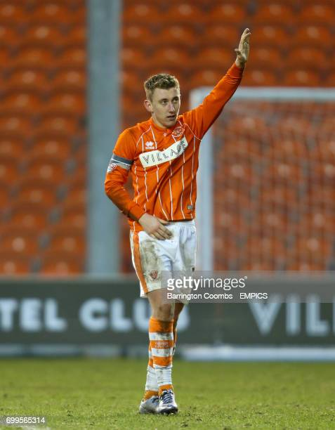 Blackpool's David Ferguson salutes the fans after the final whistle