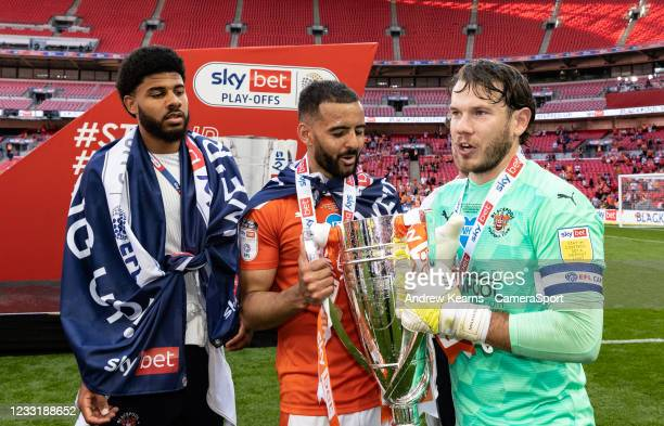Blackpool's Ellis Simms , Kevin Stewart and Chris Maxwell celebrate with the EFL trophy during the Sky Bet League One Play-off Final match between...