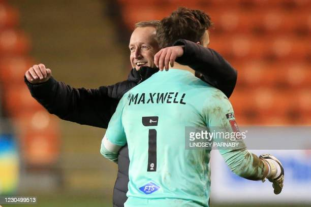 Blackpool's English head coach Neil Critchley embraces Blackpool's Welsh goalkeeper Chris Maxwell on the pitch after the English FA Cup third round...