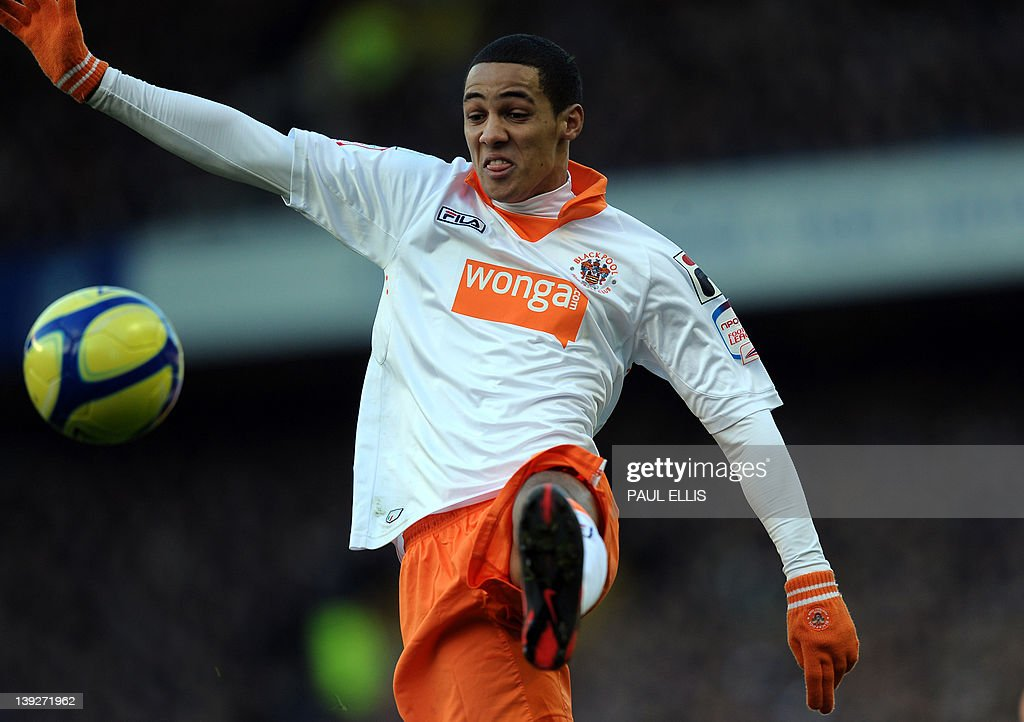 "Blackpool's English midfielder Thomas Ince controls the ball during the English FA Cup 5th Round football match between Everton and Blackpool at Goodison Park in Liverpool, north-west England on February 18, 2012. USE. No use with unauthorized audio, video, data, fixture lists, club/league logos or ""live"" services. Online in-match use limited to 45 images, no video emulation. No use in betting, games or single club/league/player publications"