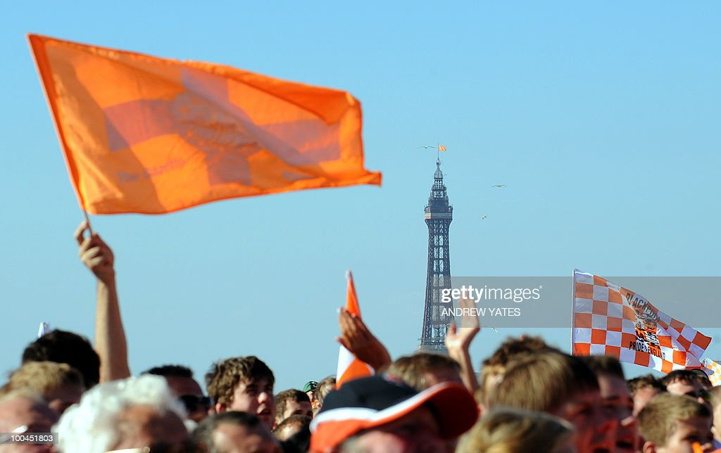 Blackpool's famous tower sits in the background as fans celebrate at their promotion party in Blackpool, north west England, on May 24, 2010, after winning promotion to the Premier League by beating Cardiff.