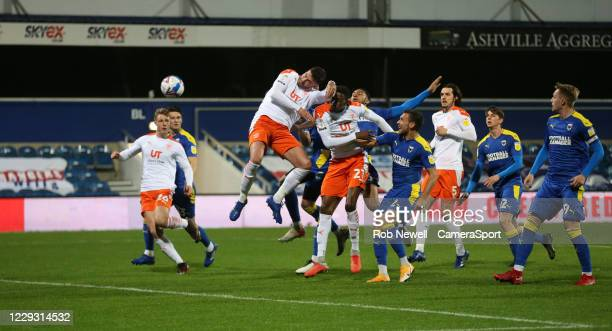 Blackpool's Gary Madine goes close with a first half header during the Sky Bet League One match between AFC Wimbledon and Blackpool at The Kiyan...