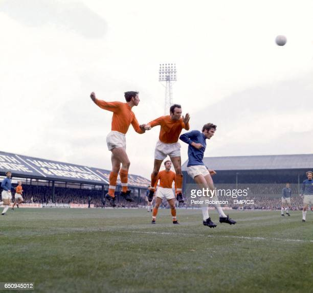 Blackpool's Glyn James and Jimmy Armfield head clear from Cardiff City's John Toshack watched by teammate Gordon Milne