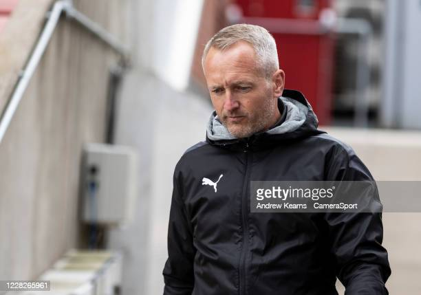 Blackpool's head coach Neil Critchley heads to the pitch from the changing room during the Carabao Cup First Round match between Stoke City and...