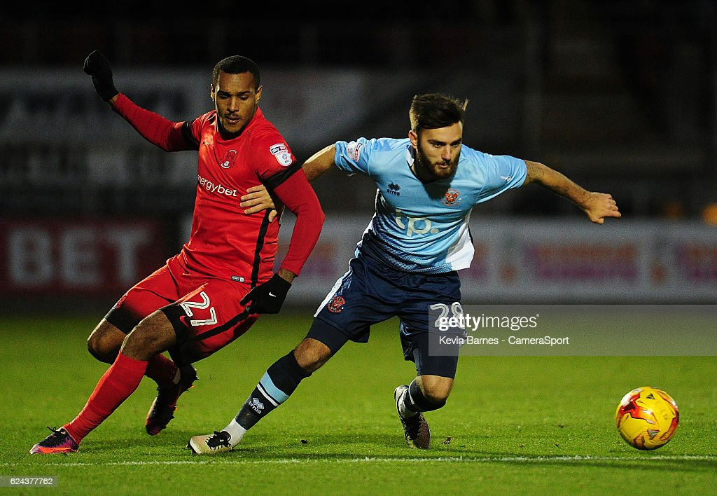 Blackpool's Jack Payne vies for possession with Leyton Orient's Jay Simpson during the Sky Bet League Two match between Leyton Orient and Blackpool at Brisbane Road on November 19, 2016 in London, England.