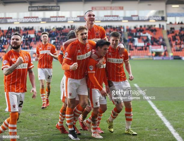 Blackpool's Jack Redshaw celebrates scoring his penalty against Gillingham with his team mates