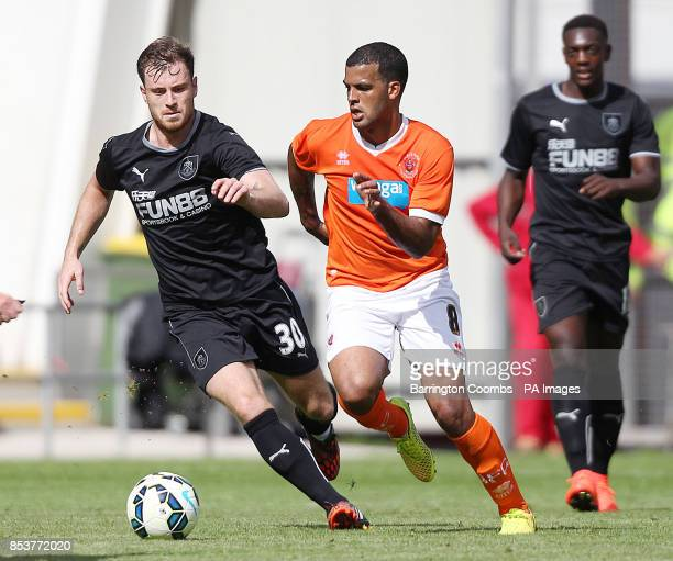 Blackpool's Jacob Mellis and Burnley's Ashley Barnes battle for the ball during the PreSeason friendly at Bloomfield Road Blackpool