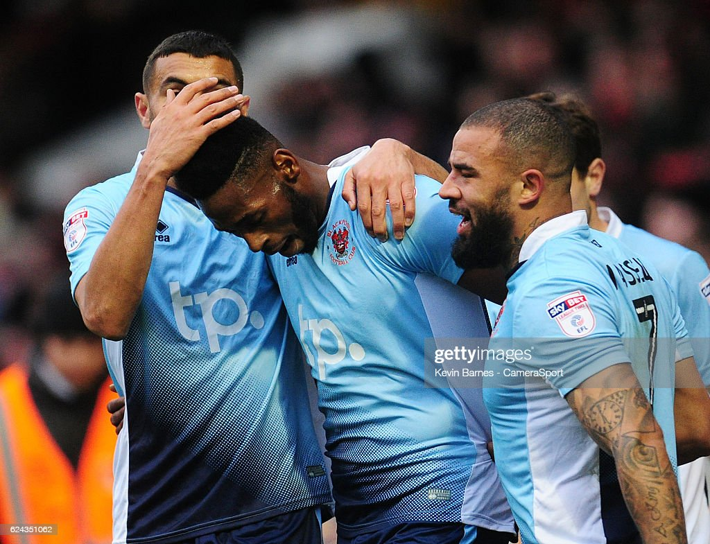 Blackpool's Jamille Matt (centre) celebrates scoring his sides first goal with team-mate Colin Daniel (left) and Kyle Vassell during the Sky Bet League Two match between Leyton Orient and Blackpool at Brisbane Road on November 19, 2016 in London, England.