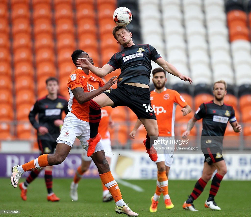 Blackpool's Jamille Matt jumps with Doncaster Rovers' Jordan Houghton during the Sky Bet League Two match between Blackpool and Doncaster Rovers at Bloomfield Road on October 22, 2016 in Blackpool, England.