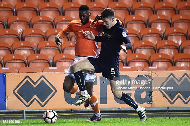 Blackpool's Jamille Matt vies for possession with Barnsley's Angus MacDonald during the Emirates FA Cup Third Round match between Blackpool and...