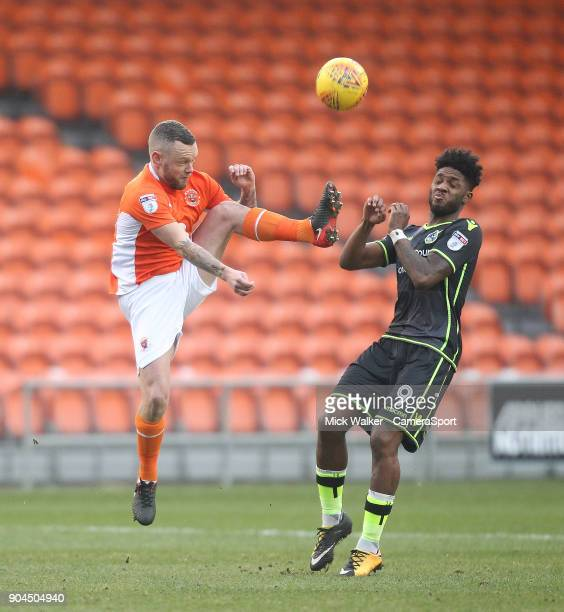 Blackpool's Jay Spearing battles with Bristol Rovers' Ellis Harrison during the Sky Bet League One match between Blackpool and Bristol Rovers at...