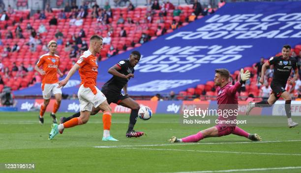 Blackpool's Jerry Yates beats Lincoln City's Alex Palmer with a chip but could not find the net during the Sky Bet League One Play-off Final match...