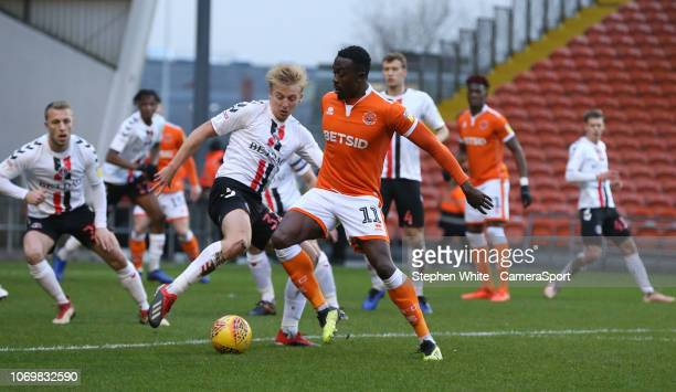 Blackpool's Joe Dodoo and Charlton Athletic's George Lapslie during the Sky Bet League One match between Blackpool and Charlton Athletic at...