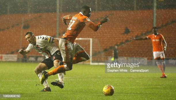 Blackpool's Joe Dodoo avoids the challenge from Charlton Athletic's Jason Pearce during the Sky Bet League One match between Blackpool and Charlton...