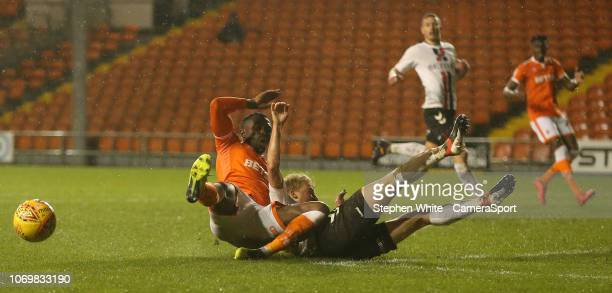 Blackpool's Joe Dodoo is tackled by Charlton Athletic's George Lapslie during the Sky Bet League One match between Blackpool and Charlton Athletic at...