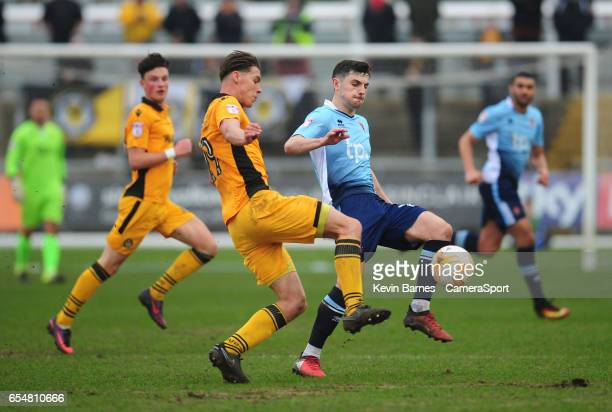 Blackpool's Jordan Flores vies for possession with Newport County's Sid Nelson during the Sky Bet League Two match between Newport County and...