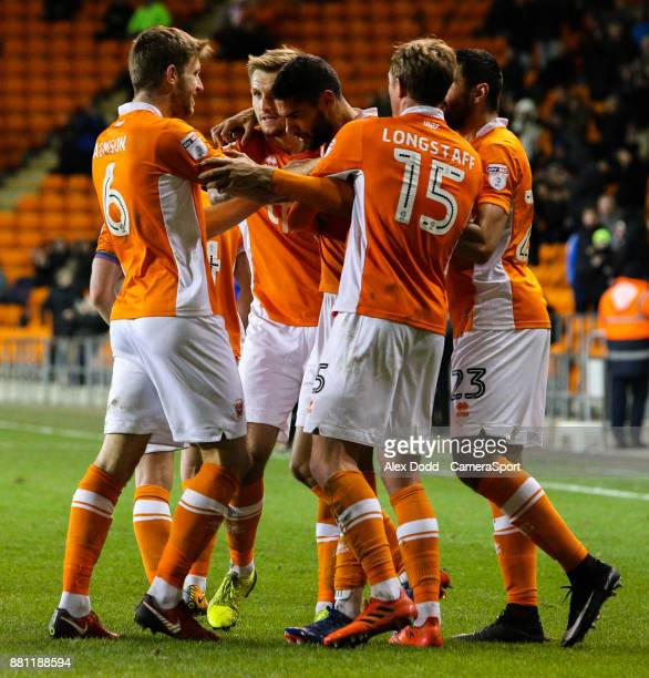 Blackpool's Kelvin Mellor celebrates with teammates after scoring his side's equalising goal to make the score 11 during the Sky Bet League One match...