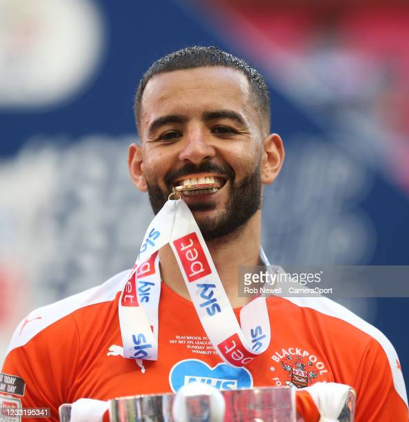 Blackpool's Kevin Stewart with his medal between his teeth during the Sky Bet League One Play-off Final match between Blackpool and Lincoln City at...