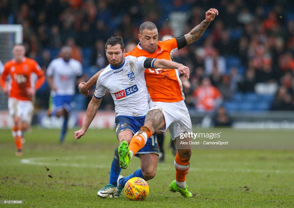 Blackpool's Kyle Vassell battles with Bury's Phil Edwards during the Sky Bet League One match between Bury and Blackpool at Gigg Lane on February 3, 2018 in Bury, England.
