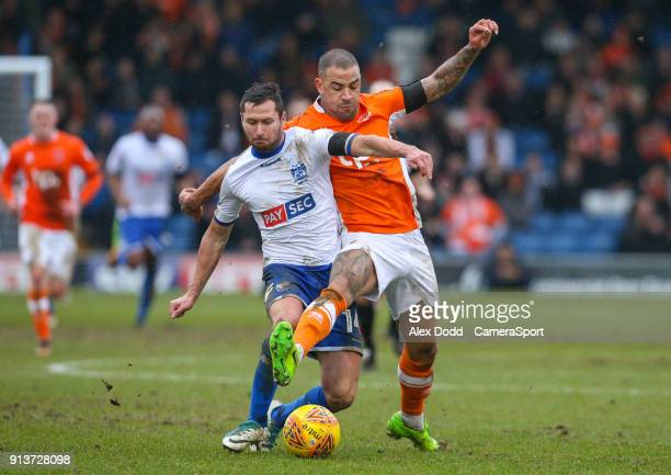 Blackpool's Kyle Vassell battles with Bury's Phil Edwards during the Sky Bet League One match between Bury and Blackpool at Gigg Lane on February 3...