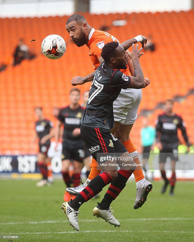 Blackpool's Kyle Vassell battles with Doncaster Rovers' Cedric Evina during the Sky Bet League Two match between Blackpool and Doncaster Rovers at Bloomfield Road on October 22, 2016 in Blackpool, England.