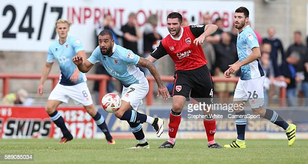 Blackpool's Kyle Vassell battles with Morecambe's Alex Kenyon during the EFL Sky Bet League Two match between Morecambe and Blackpool at the Globe...