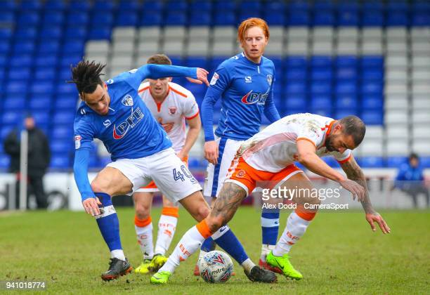 Blackpool's Kyle Vassell battles with Oldham Athletic's Kean Bryan during the Sky Bet League One match between Oldham Athletic and Blackpool at...