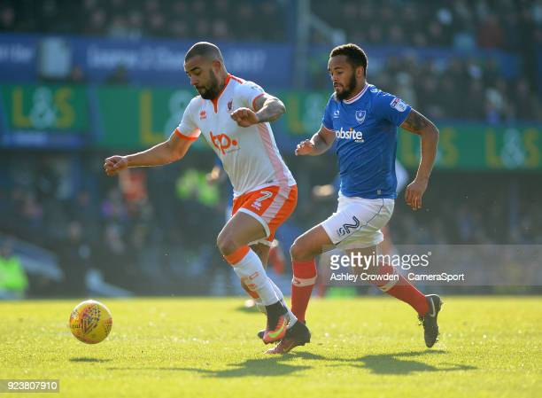 Blackpool's Kyle Vassell battles with Portsmouth's Anton Walkes during the Sky Bet League One match between Portsmouth and Blackpool at Fratton Park...