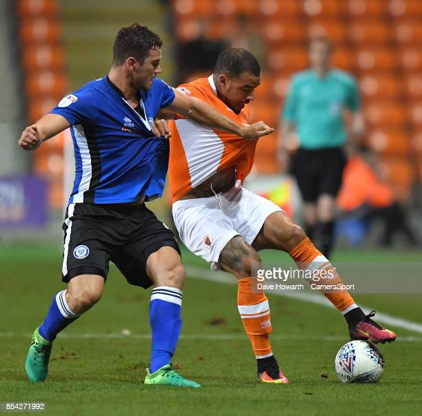 Blackpool's Kyle Vassell battles with Rochdale's Harrison McGahey during the Sky Bet League One match between Blackpool and Rochdale at Bloomfield...