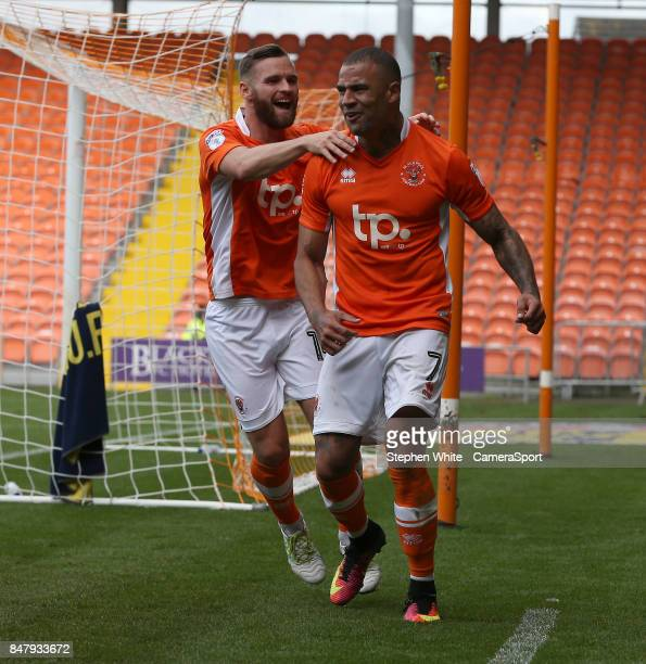 Blackpool's Kyle Vassell celebrates scoring his second and his side's third goal with teammate Jimmy Ryan during the Sky Bet League One match between...